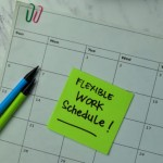 Flexible Work Schedule write on sticky notes isolated on office desk.